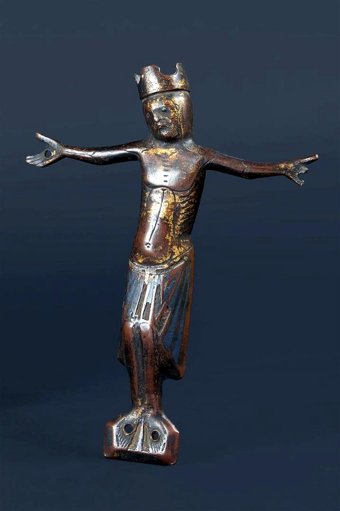 A Romanesque champlevé enamelled and gilt copper cross with a champlevé enamelled and gilt copper figure of a Christ Limoges France